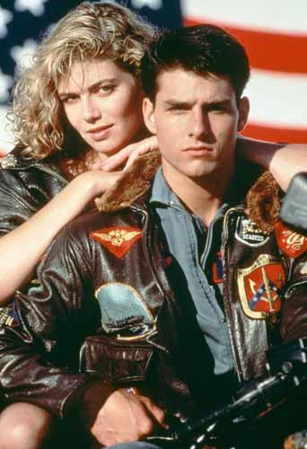American actors Tom Cruise, as Lieutenant Pete 'Maverick' Mitchell, and Kelly McGillis, as Charlotte 'Charlie' Blackwood, in a promotional portrait for 'Top Gun', directed by Tony Scott, 1986. (Photo by Paramount Pictures/Archive Photos/Getty Images)